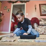 12.02.10 Gabe and his money collection 1