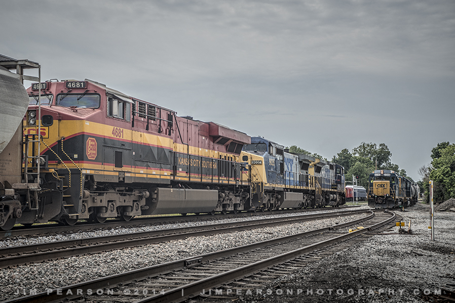 August 7, 2014 - Two CSX trains meet on the outskirts of La Grange, Ky, one with Kansas City Southern's 4681 as the trailing unit.