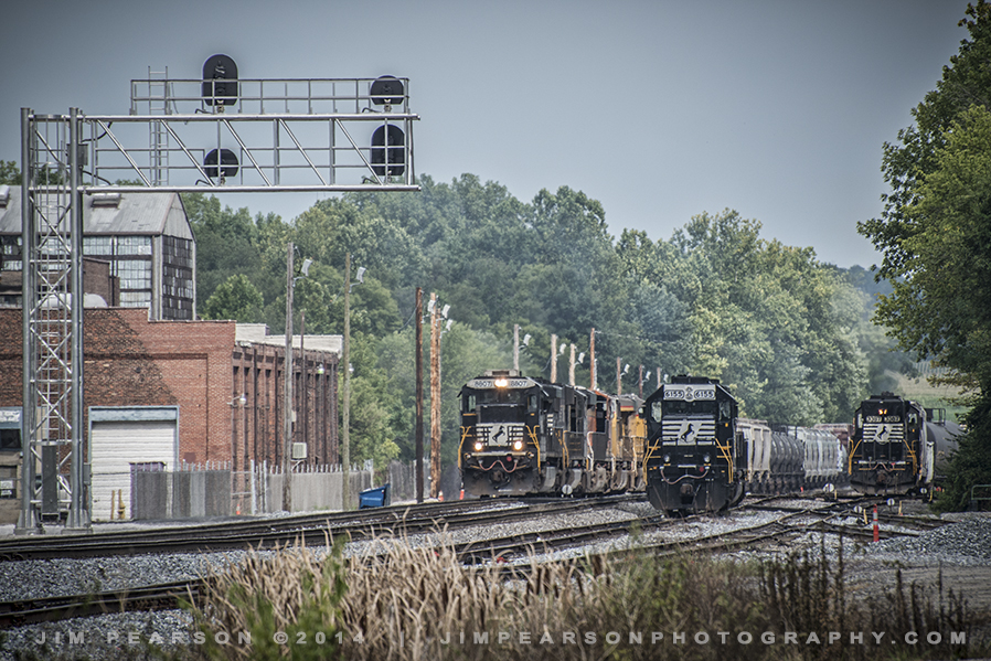 August 10, 2014 - A Norfolk Southern train, left, prepares to leave the yard at Princeton, Indiana as another works on building a train on the right.