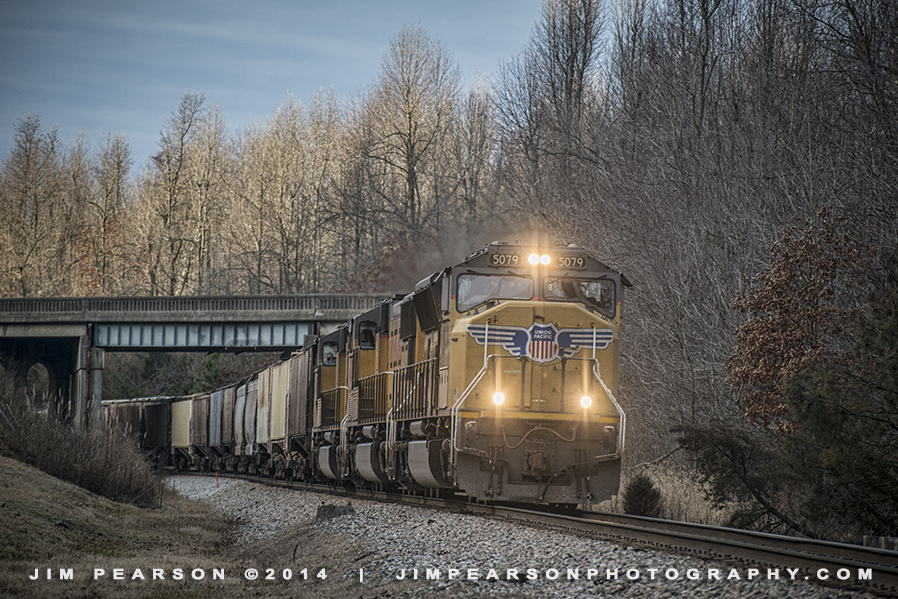 December 31, 2014 - CSX V265-30, a empty UP powered grain train passes under the US 41 overpass as it heads north into Mortons Gap, Ky, with engine 5079 in the lead, as it heads towards Evansville, Indiana on the Henderson Subdivision.