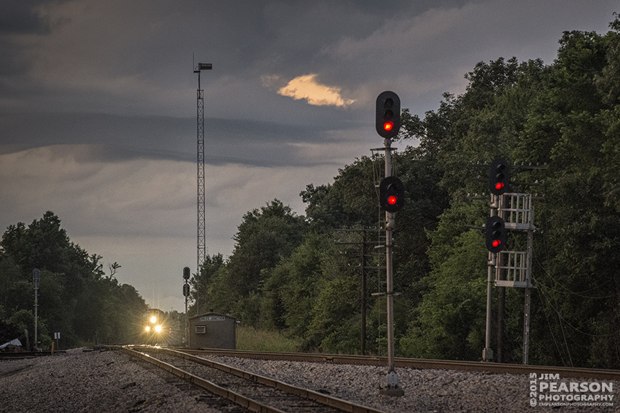 June 26, 2015 - Southbound CN manifest train with engine 5721 as it's leading engine, waits for a green signal at Chiles Junction in Paducah, Ky as light fades from the day. CN is the lower track and the upper track belongs to Paducah & Louisville Railway. - Tech Info: 1/320sec, f/5.6, ISO 4000, Lens: Nikon 70-300 @ 185mm with a Nikon D800 shot and processed in RAW. #jimstrainphotos