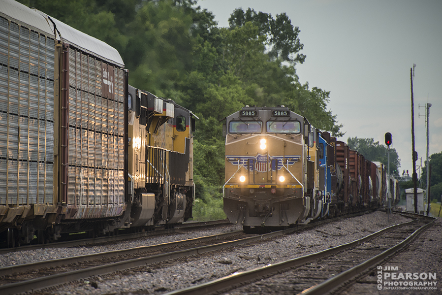 June 6, 2015 - A Union Pacific Railroad autorack train meets a southbound manifest at Gorham, Illinois as it makes its way north on the Chester Subdivision. - Tech Info: 1/1250 sec, f/5.6, ISO 500, Lens: Nikon 70-300 @ 300mm with a Nikon D800 shot and processed in RAW. #jimstrainphotos