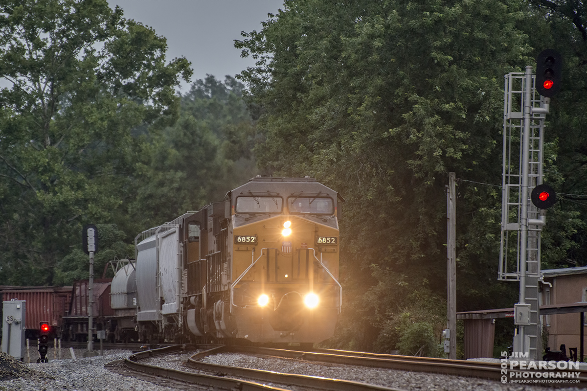July 11, 2015 - Norfolk Southerns 112w passes the signal at the East end of the siding at Taswell, Indiana as it heads west with UP 6852 on point. - Tech Info: 1/500sec, f/5.6, ISO 4000, Lens: Nikon 70-300 @ 300mm with a Nikon D800 shot and processed in RAW.?