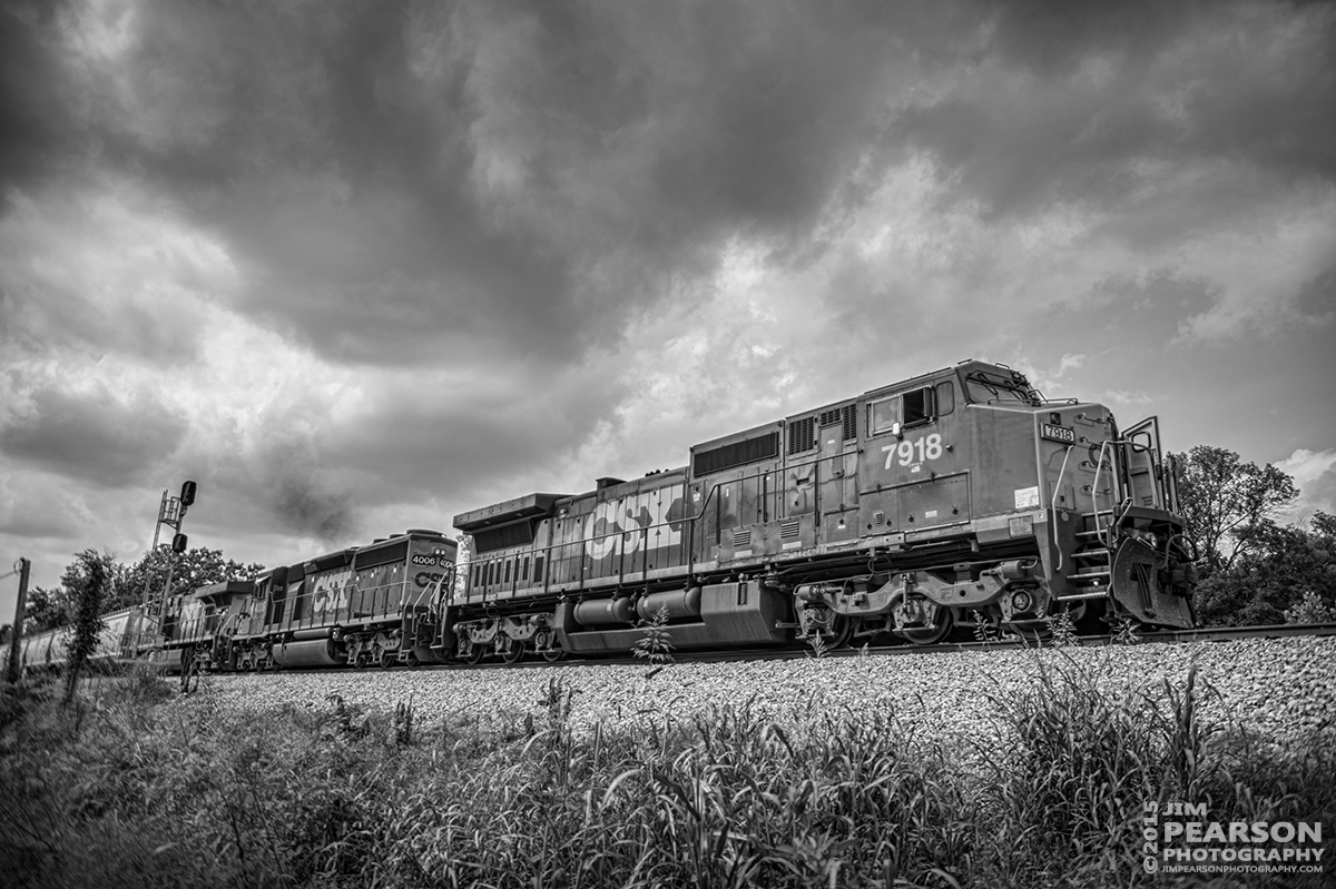 July 22, 2015 - Loaded grain train CSX G102, (Martinsville, IL - Rockmart, GA), passes the signals at the north end of Casky as it moves south on the Henderson Subdivision at Hopkinsville, Ky. - Tech Info: 1/2000sec, f/2.8, ISO 160, Lens: Sigma 24-70 @ 24mm with a Nikon D800 shot and processed in RAW.