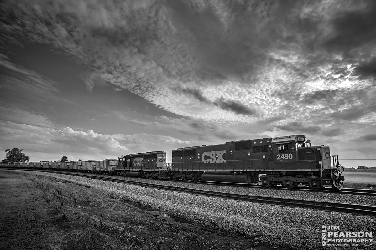 July 22, 2015 - CSX W007 passes the north end of the siding at Kelly, Ky as it moves it's ballast train north on the Henderson Subdivision. - Tech Info all photos: 1/2000sec, f/2.8, ISO 160, Lens: Rokinon 14mm with a Nikon D800 shot and processed in RAW.