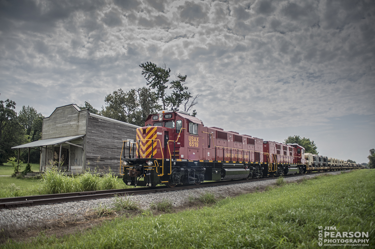 July 27, 2015 - United States Army GenSets 6519 and 6520 pass an old general store at the Fidelio Road Crossing in Pembroke, Ky, as they move a loaded military train from Ft. Campbell Army Post to CSX's Fort Campbell Wye in Hopkinsville, Ky. There CSX picked up the train and took it on north on the Henderson Subdivision. - Tech Info: 1/2000sec, f/2.8, ISO 125, Lens: Sigma 24-70 @ 24mm with a Nikon D800 shot and processed in RAW.