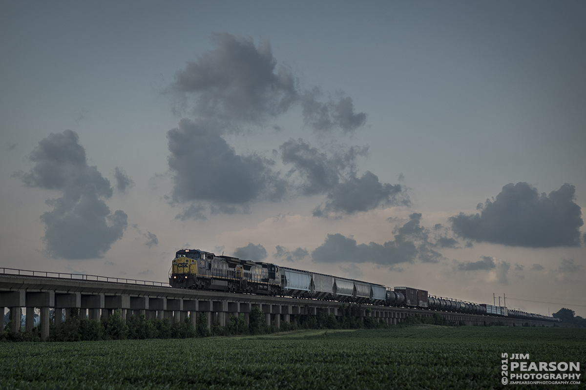 July 28, 2015 - CSX Q649 heads up the viaduct at Rahm, Indiana approaching the bridge over the the Ohio River as it moves it's train south on CSX's Henderson Subdivision. - Tech Info: 1/1000sec, f/5.6, ISO 220, Lens: Sigma 24-70 @ 70mm with a Nikon D800 shot and processed in RAW.