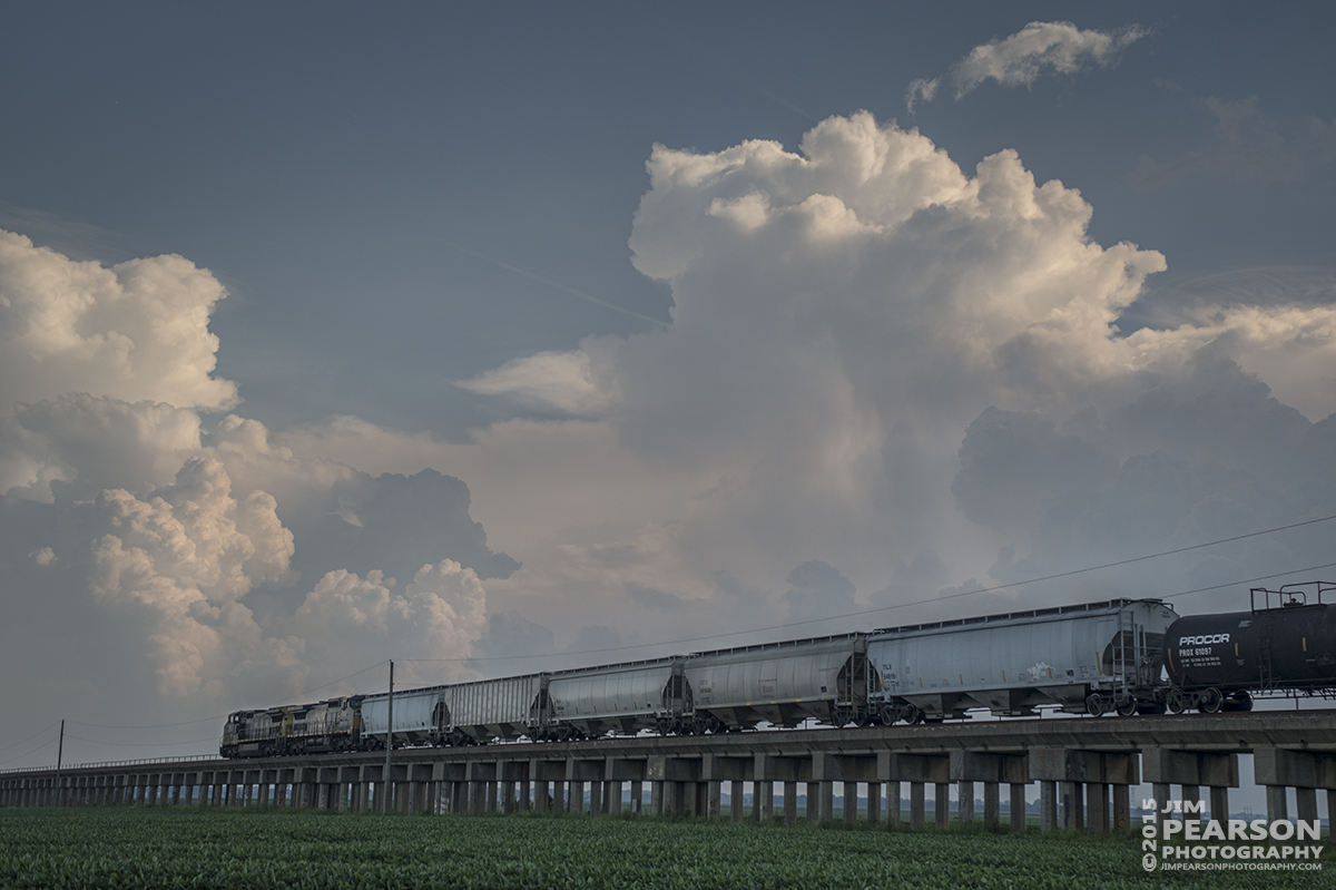 July 28, 2015 - CSX Q649 heads up the viaduct at Rahm, Indiana as a thunderstorm looms in the background as it heads south on the Henderson Subdivision. - Tech Info: 1/1000sec, f/5.6, ISO 280, Lens: Sigma 24-70 @ 46mm with a Nikon D800 shot and processed in RAW.