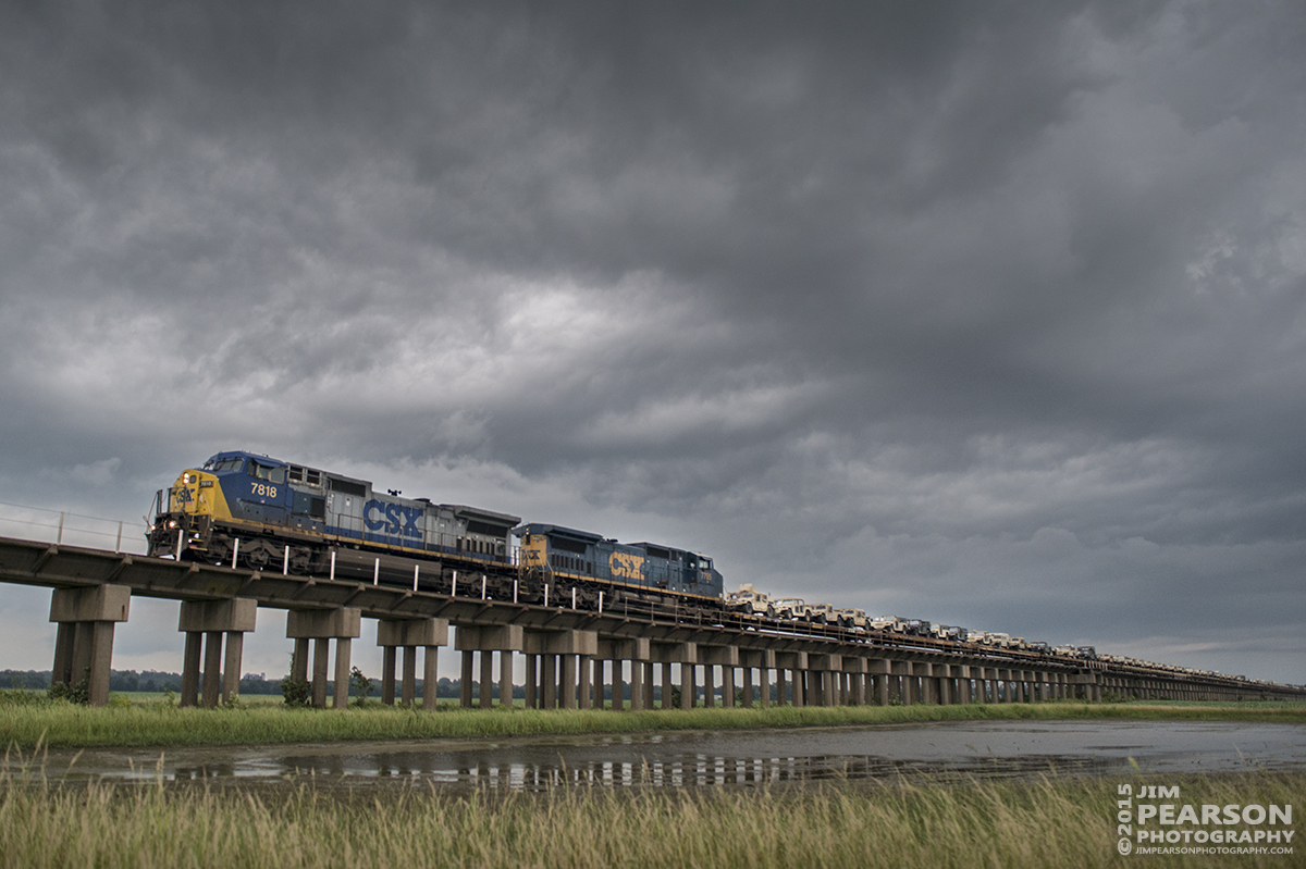 July 28, 2015 - CSX W861-28 heads down the viaduct at Rahm, Indiana, after coming over the Ohio River bridge at Henderson, Ky, as it moves it's military cargo train north on CSX's Henderson Subdivision with stormy skies overhead. - Tech Info: 1/500sec, f/4, ISO 900, Lens: Sigma 24-70 @ 24mm with a Nikon D800 shot and processed in RAW