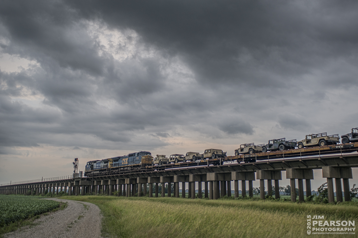 July 28, 2015 - CSX W861-28 heads down the viaduct at Rahm, Indiana, after coming over the Ohio River bridge at Henderson, Ky, as it moves it's military cargo train north on CSX's Henderson Subdivision with stormy skies overhead. - Tech Info: 1/500sec, f/4, ISO 360, Lens: Sigma 24-70 @ 40mm with a Nikon D800 shot and processed in RAW.