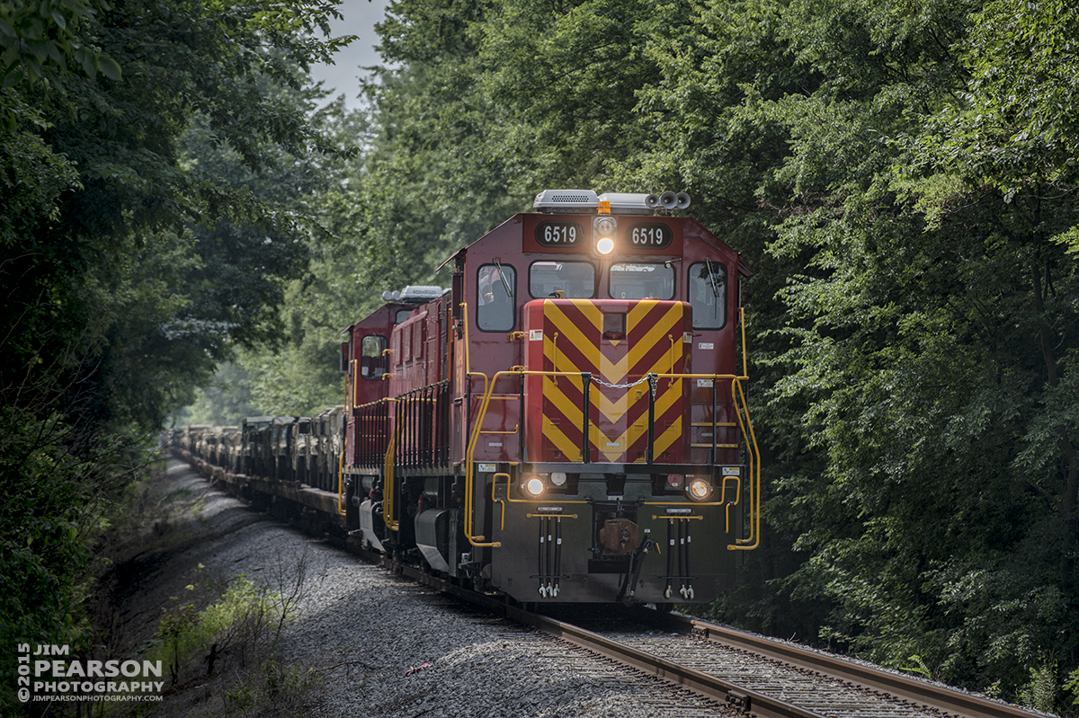 July 28, 2015 - United States Army GenSets 6519 and 6520 approach Locust Grove Road, just off of highway 41A at Hopkinsville, Ky, as they move a loaded military train from Ft. Campbell Army Post to CSX's Fort Campbell Wye in Hopkinsville to be interchanged with CSX who took it on north on the Henderson Subdivision as train W861-28. - Tech Info: 1/1600sec, f/5.6, ISO 400, Lens: Nikon 70-300 @ 145mm with a Nikon D800 shot and processed in RAW