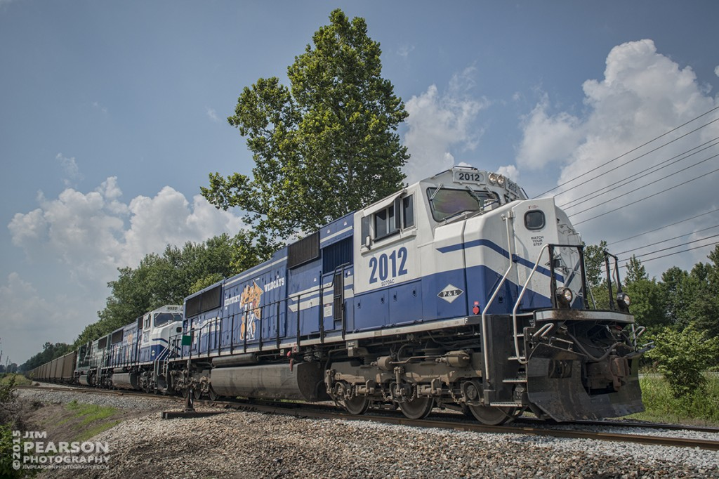 July 28, 2015 - Paducah and Louisville's University of Kentucky engines 2012 and 4522 lead a loaded coal train as it as it heads east past the the PeeVee Spur on CSX's Morganfield Branch in Madisonville, Ky.