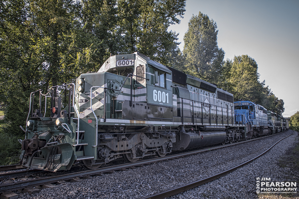 August 11, 2015 - Evansville Western Railway's engine 6001 leads a loaded coal train south on the Paducah and Louisville Railway as it enters Richland, Ky with NERX 7351, EVWR 6002 and 6003 as the rest of the power. - Tech Info: 1/320sec, f/5.6, ISO 720, Lens: Sigma 24-70 @ 24mm with a Nikon D800 shot and processed in RAW.
