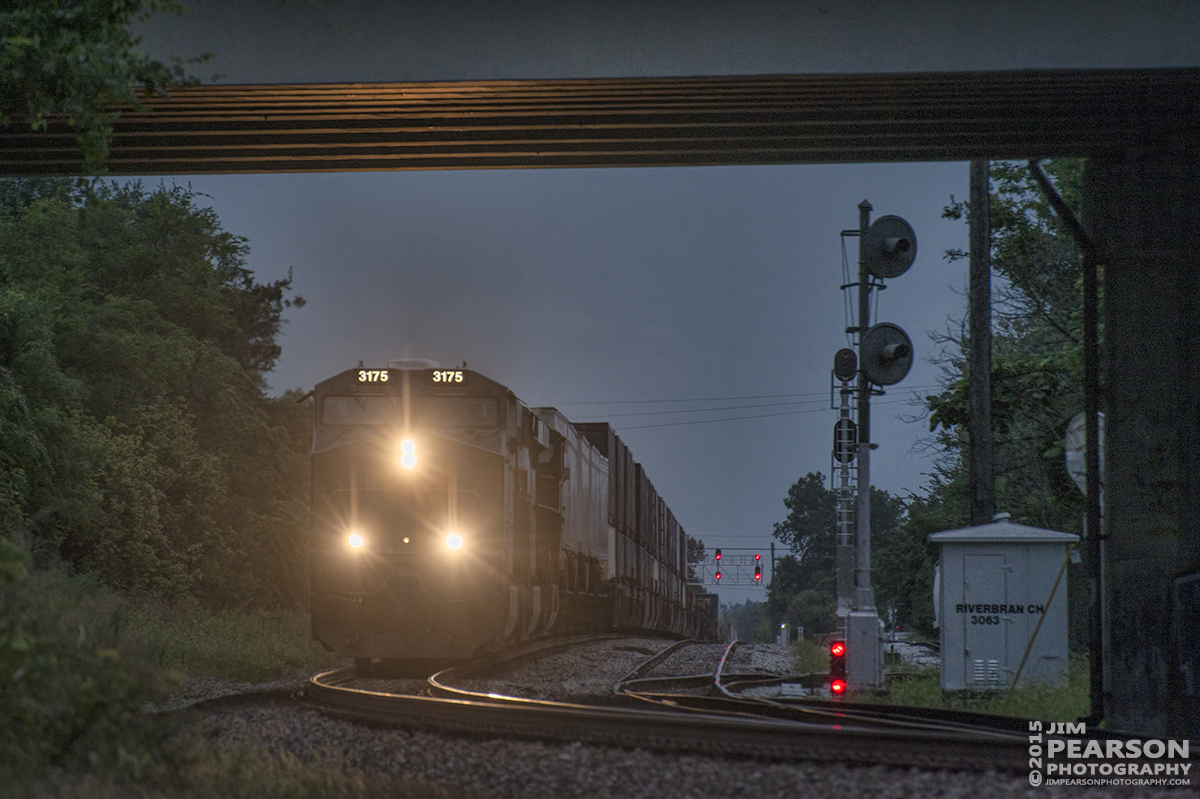 August 19, 2015 - CSX Q026 passes the signals for the River Branch line as it heads north under the 2nd Street Bridge approaching the old L&N Depot at Henderson, Ky on the Henderson Subdivision at dusk.  – Tech Info: 1/640sec, f/5.5, ISO 360, Lens: Nikon 70-300 @ 280mm with a Nikon D800 shot and processed in RAW.