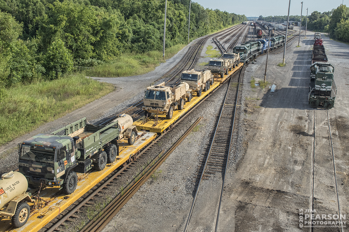 August 21, 2015 - Paducah and Louisville Railway's 2107 heads up the power for a military train as it heads into the north end of the yard at Paducah, Ky. The third unit is Natchez Railway 2602, which I understand is leased from them by P&L. The train tied down at Paducah for the night. – Tech Info: 1/1250sec, f/13, ISO 2500, Lens: Sigma 24-70 @ 36mm with a Nikon D800 shot and processed in RAW.