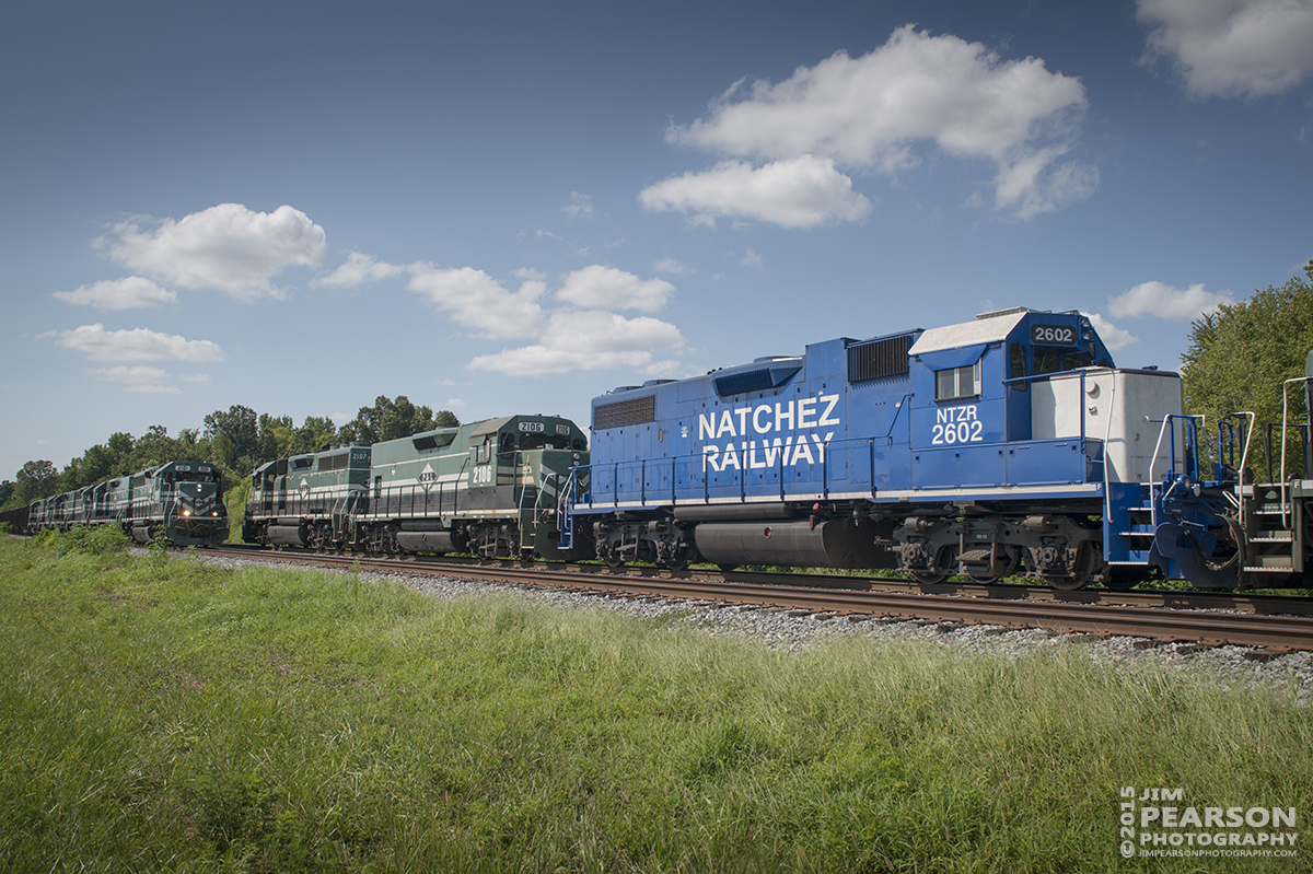August 21, 2015 - Paducah and Louisville Railway's northbound loaded coal train with 2101 in the lead, meets 2107 pulling a southbound military train at Gilbertsville, Ky, with Natchez Railway's 2602 as it's third unit. – Tech Info: 1/1000sec, f/9, ISO 360, Lens: Sigma 24-70 @ 24mm with a Nikon D800 shot and processed in RAW.