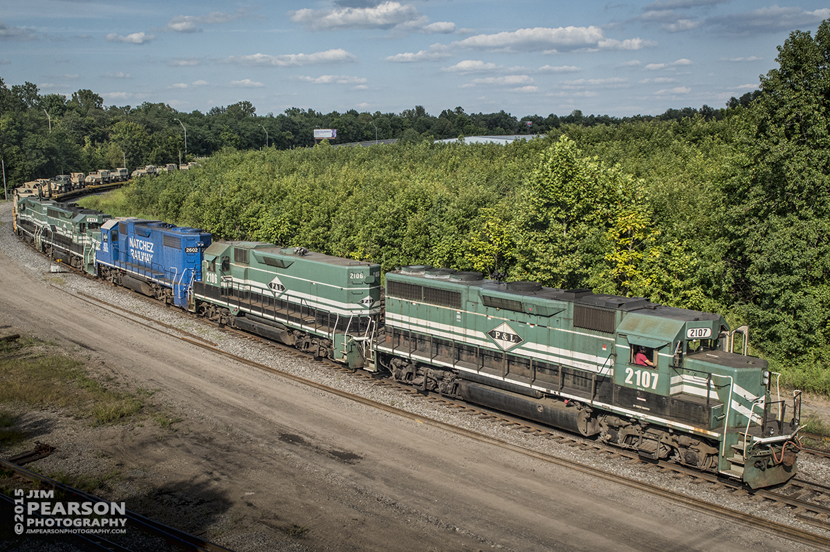August 21, 2015 - Paducah and Louisville Railway's 2107 heads up the power for a military train as it heads into the north end of the yard at Paducah, Ky. The third unit is Natchez Railway 2602, which I understand is leased from them by P&L. The train tied down at Paducah for the night. – Tech Info: 1/1250sec, f/13, ISO 1800, Lens: Sigma 24-70 @ 34mm with a Nikon D800 shot and processed in RAW.