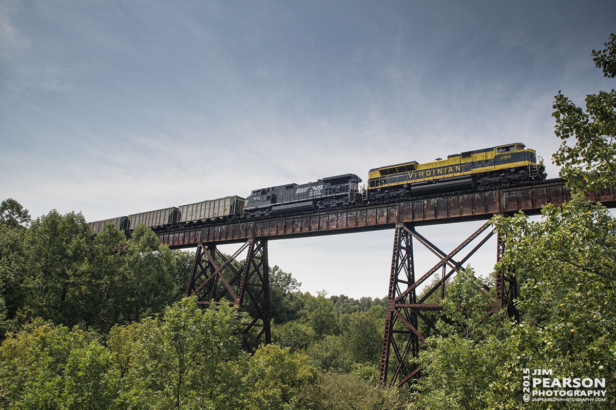 August 28, 2015 - I owe Adam Wells and Bill Grady a big shout out for the heads up with today's picture of Norfolk Southern's Heritage unit 1069, The Virginian as it head north across the trestle at Big Clifty, Ky. I almost didn't give case because as many of you know I broke my left elbow, Monday and had surgery to repair it on Wednesday! I must say it's amazing how much i find that I use my left, almost as much as my right. I did have to adapt my shooting style as my D800 with the battery grip is Heavy! However I persevered and good several nice shots between Central City and Big Clifty, Ky which I'll post over the next few days. – Tech Info: 1/1250sec, f/13, ISO 800, Lens: Sigma 24-70 @ 24mm with a Nikon D800 shot and processed in RAW.