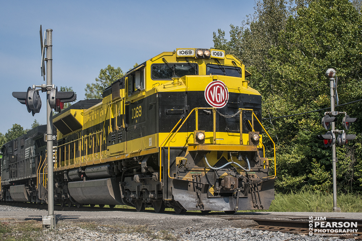 August 28, 2015 - Norfolk Southern's Heritage unit 1069, The Virginian, blows through the crossing at Coon Hollow Road, outside Caneyville, Ky on the Paducah & Louisville Railway as it heads north with a loaded coal train. – Tech Info: 1/1250sec, f/13, ISO 1000, Lens: Nikon 70-300 @ 70mm with a Nikon D800 shot and processed in RAW.