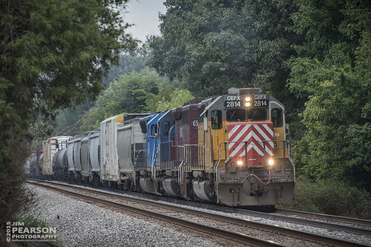 August 17, 2015 - CSX Q647-16 with three lease units as power, CEFX 2814, HLCX  6313 and CEFX 3119, head south through the siding at Hanson, Ky on the Henderson Subdivision. - Tech Info all photos: 1/2500sec, f/7, ISO 1600, Lens: Nikon 70-300 @ 250mm with a Nikon D800 shot and processed in RAW.