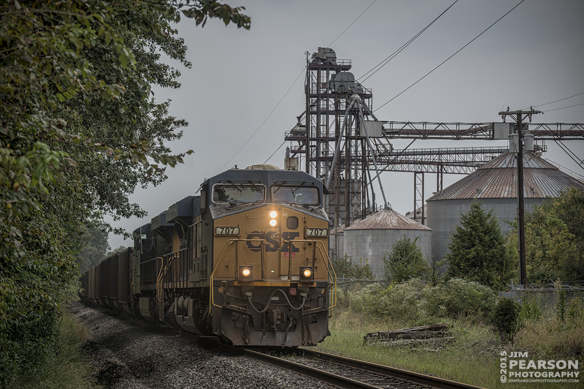 September 9, 2015 - CSX loaded coal train N008-09 approaches the Pride Avenue crossing at Madisonville,Ky on CSX's Morganfield Branch as it heads to Atkinson Yard where it continued it's move south on the Henderson Subdivision. - Tech Info all photos: 1/1250sec, f/4.5, ISO 900, Lens: Nikon 70-300 @ 110mm with a Nikon D800 shot and processed in RAW.