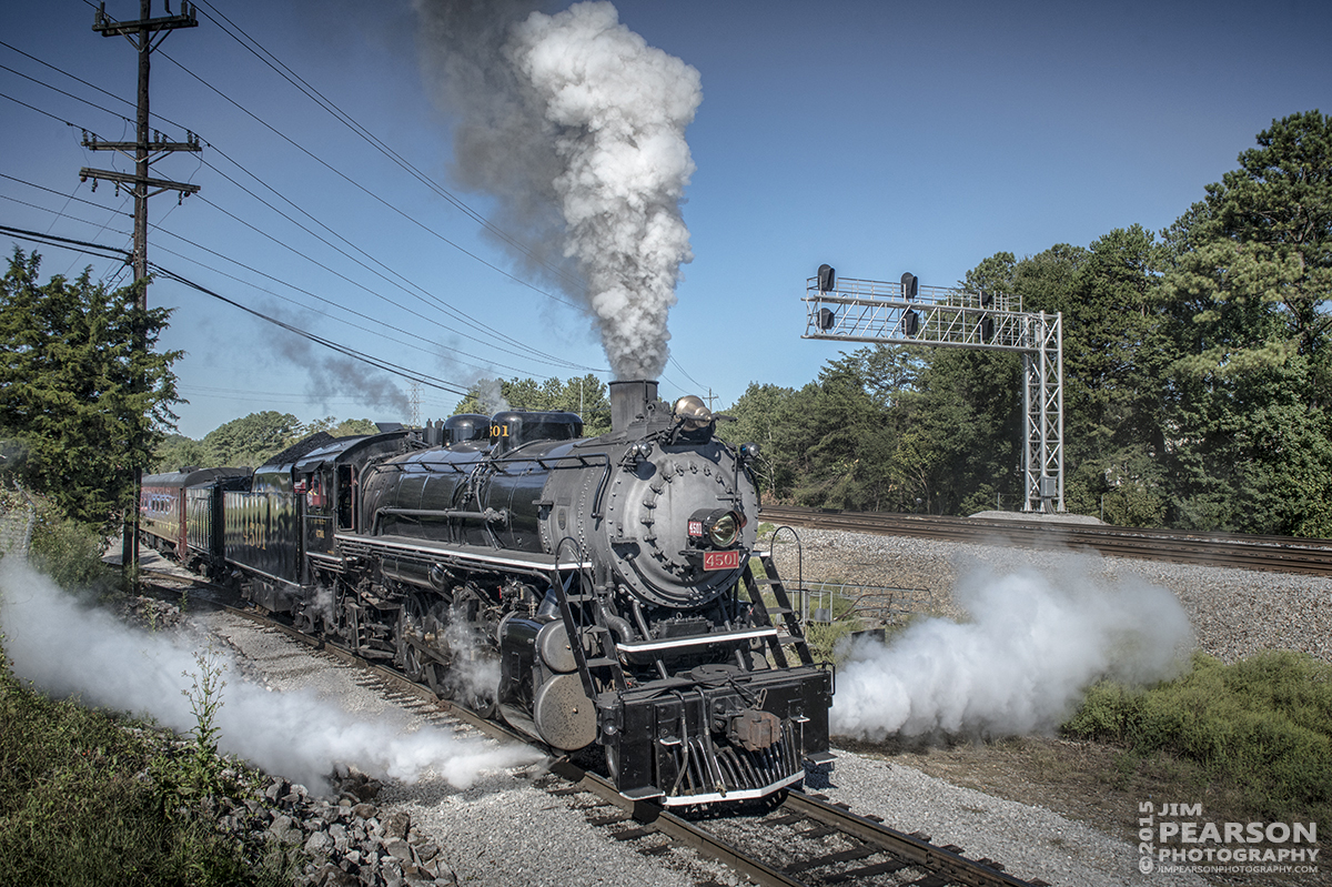 """September 13, 2015 - The Tennessee Valley Railroad Museum's Southern Railway 4501 heads from the museum onto the Norfolk Southern Mainline at Chattanooga, Tennessee with a loaded passenger train bound for a round trip to Cleveland, Tennessee during the Museum's 2015 Railfest. 4501 was built by Baldwin Locomotive Works in 1911 for the Southern Railway, the 4501 was the first of its class on that railroad. The wheel arrangement is a 2-8-2, known as a Mikado since the first of this type were sold to Japan. 4501 served the Southern until the 1940s when the railroad began buying diesel locomotives and phasing out steam operations. It then then saw service on a small coal-hauling railroad in Kentucky. Since the mid-1960s, 4501 has pulled countless passenger excursion trains across the Southern (later Norfolk Southern) Railway. The 4501 ended its service in 1999 due to rising maintenance costs. However, with the start of Norfolk Southern's """"21st Century Steam"""" program, the 4501 returned to service this year. Tech Info all photos: 1/1250sec, f/10, ISO 900, Lens: Sigma 24-70 @ 24mm with a Nikon D800 shot and processed in RAW. ?#?jimstrainphotos?"""