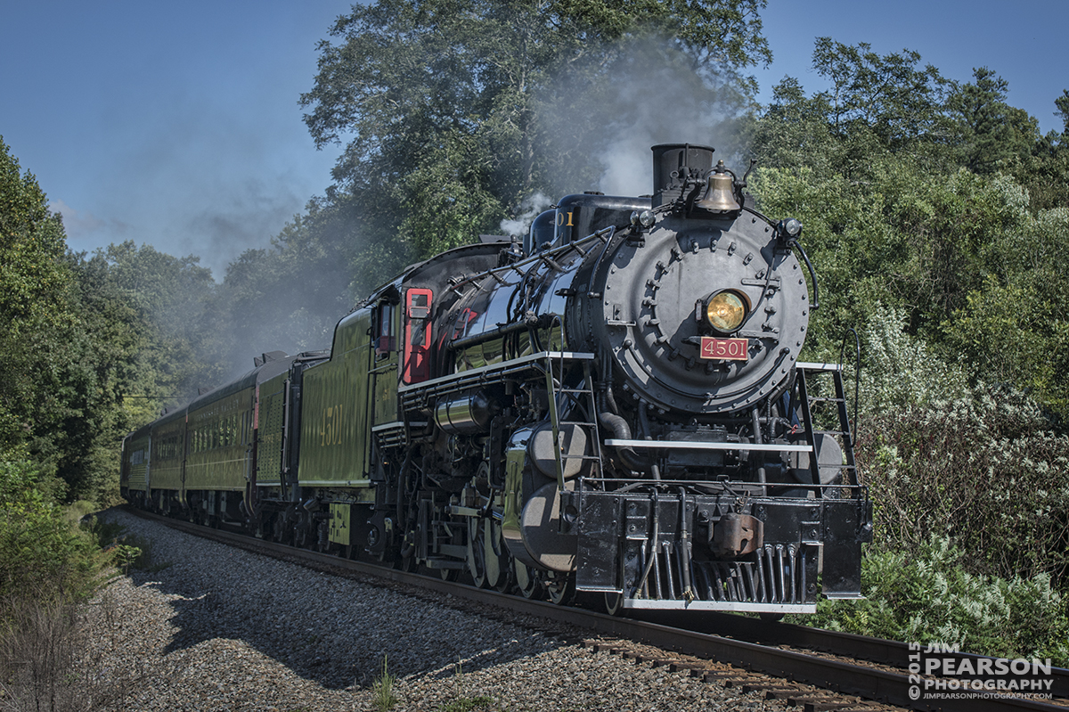 """September 12, 2015 - The Tennessee Valley Railroad Museum's Southern Railway 4501 heads west on the Norfolk Southern Mainline at Pine Hill Road, McDonald, Tennessee during it's return trip to Chattanooga with a loaded passenger train from Cleveland, during the Museum's 2015 Railfest. 4501 was built by Baldwin Locomotive Works in 1911 for the Southern Railway, the 4501 was the first of its class on that railroad. The wheel arrangement is a 2-8-2, known as a Mikado since the first of this type were sold to Japan. 4501 served the Southern until the 1940s when the railroad began buying diesel locomotives and phasing out steam operations. It then then saw service on a small coal-hauling railroad in Kentucky. Since the mid-1960s, 4501 has pulled countless passenger excursion trains across the Southern (later Norfolk Southern) Railway. The 4501 ended its service in 1999 due to rising maintenance costs. However, with the start of Norfolk Southern's """"21st Century Steam"""" program, the 4501 returned to service this year. Tech Info: 1/1000sec, f/7, ISO 450, Lens: Nikon 70-300 @ 70mm with a Nikon D800 shot and processed in RAW."""