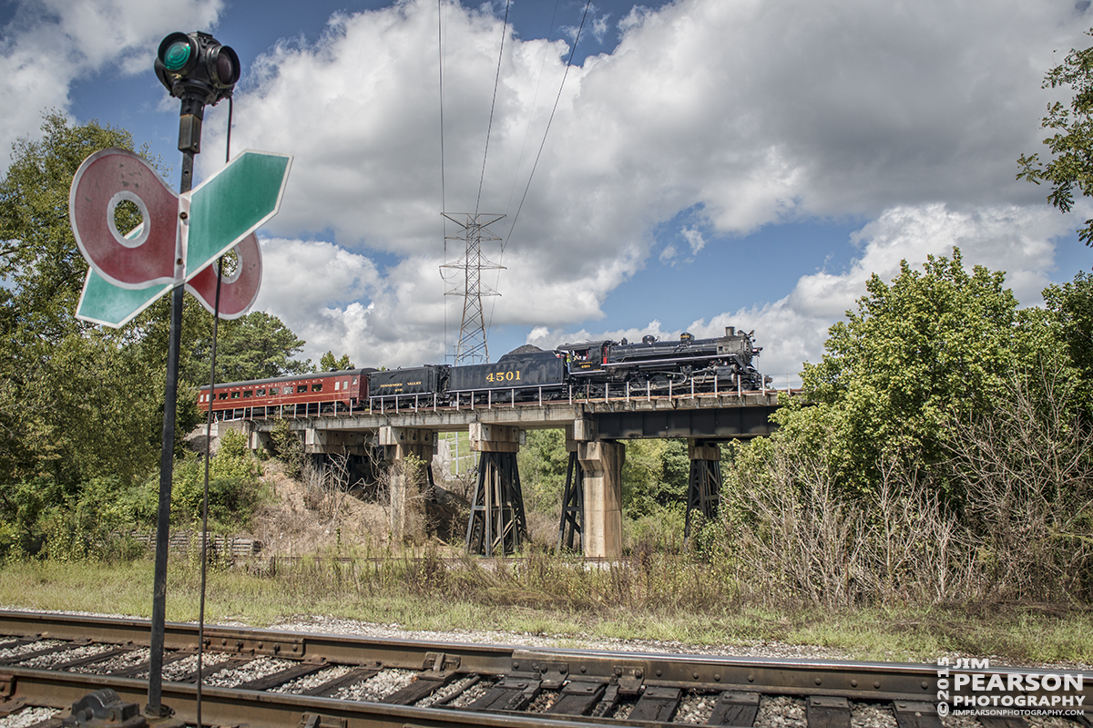 """September 12, 2015 - The Tennessee Valley Railroad Museum's Southern Railway 4501 returns to the station at the museum after turning on the wye at Citco Junction on Norfolk Southern's mainline, during it's return trip from Cleveland on the Norfolk Southern Mainline at Chattanooga, Tennessee with a loaded passenger train during 2015 Railfest.  4501 was built by Baldwin Locomotive Works in 1911 for the Southern Railway, the 4501 was the first of its class on that railroad. The wheel arrangement is a 2-8-2, known as a Mikado since the first of this type were sold to Japan. 4501 served the Southern until the 1940s when the railroad began buying diesel locomotives and phasing out steam operations. It then then saw service on a small coal-hauling railroad in Kentucky. Since the mid-1960s, 4501 has pulled countless passenger excursion trains across the Southern (later Norfolk Southern) Railway. The 4501 ended its service in 1999 due to rising maintenance costs. However, with the start of Norfolk Southern's """"21st Century Steam"""" program, the 4501 returned to service this year. Tech Info: 1/1250sec, f/7, ISO 250, Lens: Sigma 24-70 @ 24mm with a Nikon D800 shot and processed in RAW."""