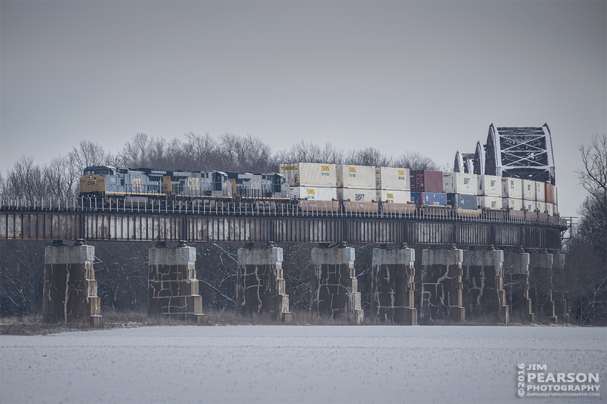 January 20, 2016 - CSX Q028 makes its way down the viaduct at Rham, Indiana, crossing the bridge at the Ohio River in Henderson, KY, as it heads south on the Henderson Subdivision. - Tech Info: 1/1250 | f/5.6 | ISO 100 | Lens: Sigma 150-600 @ 300mm with a Nikon D800 shot and processed in RAW.