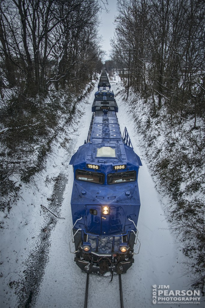 "January 20, 2016 - SavaTrans' SS1 makes its way north with a empty coal train with SVTX 1986 and 1982 as power, at Mount Vernon, Indiana. The Chris Cline Group are owners of the company ""Savatrans"" which purchased three ES44AC locomotives numbered to represent the Penn State Championship football years # 1912, 1982, & 1986. Operating from Sugar Camp Mine in Akin, IL to Abee, IN near Mount Vernon/West Franklin area. - Tech Info: 1/1000 