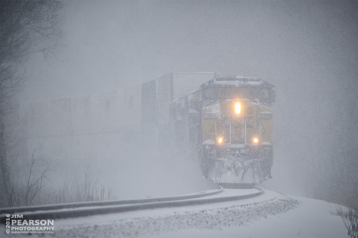 January 22, 2016 - CSX Q028 approaches the south end of Romney siding at Nortonville, Ky, through the heavy snowfall, as it heads north on the Henderson Subdivision. - Tech Info: 1/1250 | f/6 | ISO 800 | Lens: Sigma 150-600 @ 450mm with a Nikon D800 shot and processed in RAW.