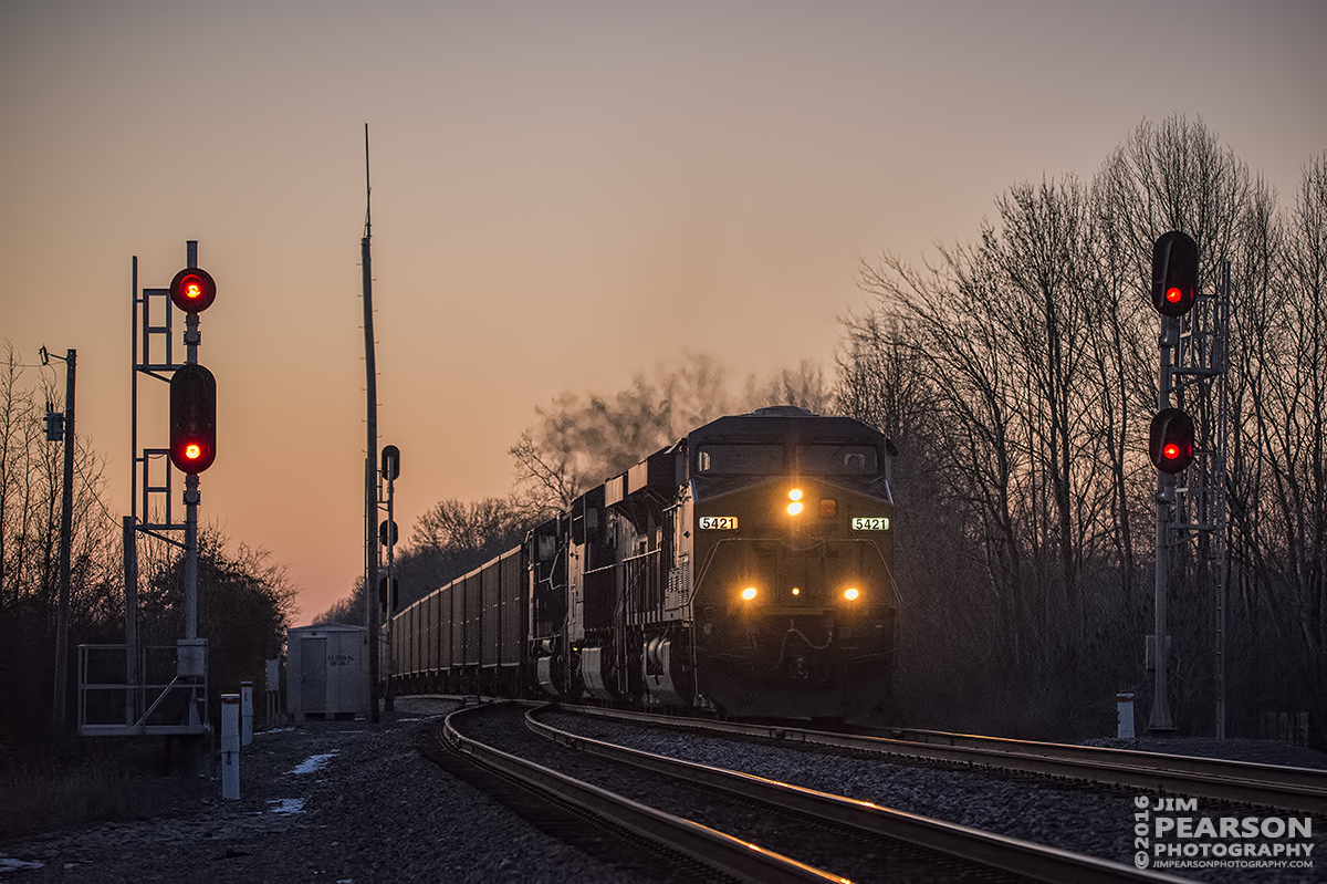 January 28, 2016 - CSX loaded coal train N006-27 passes the signals at the north end of Cedar Hill, Tennessee siding as the light fades from the sky on the Henderson Subdivision. - Tech Info: 1/1250 | f/5 | ISO 3600 | Lens: Sigma 150-600 @ 150mm with a Nikon D800 shot and processed in RAW.