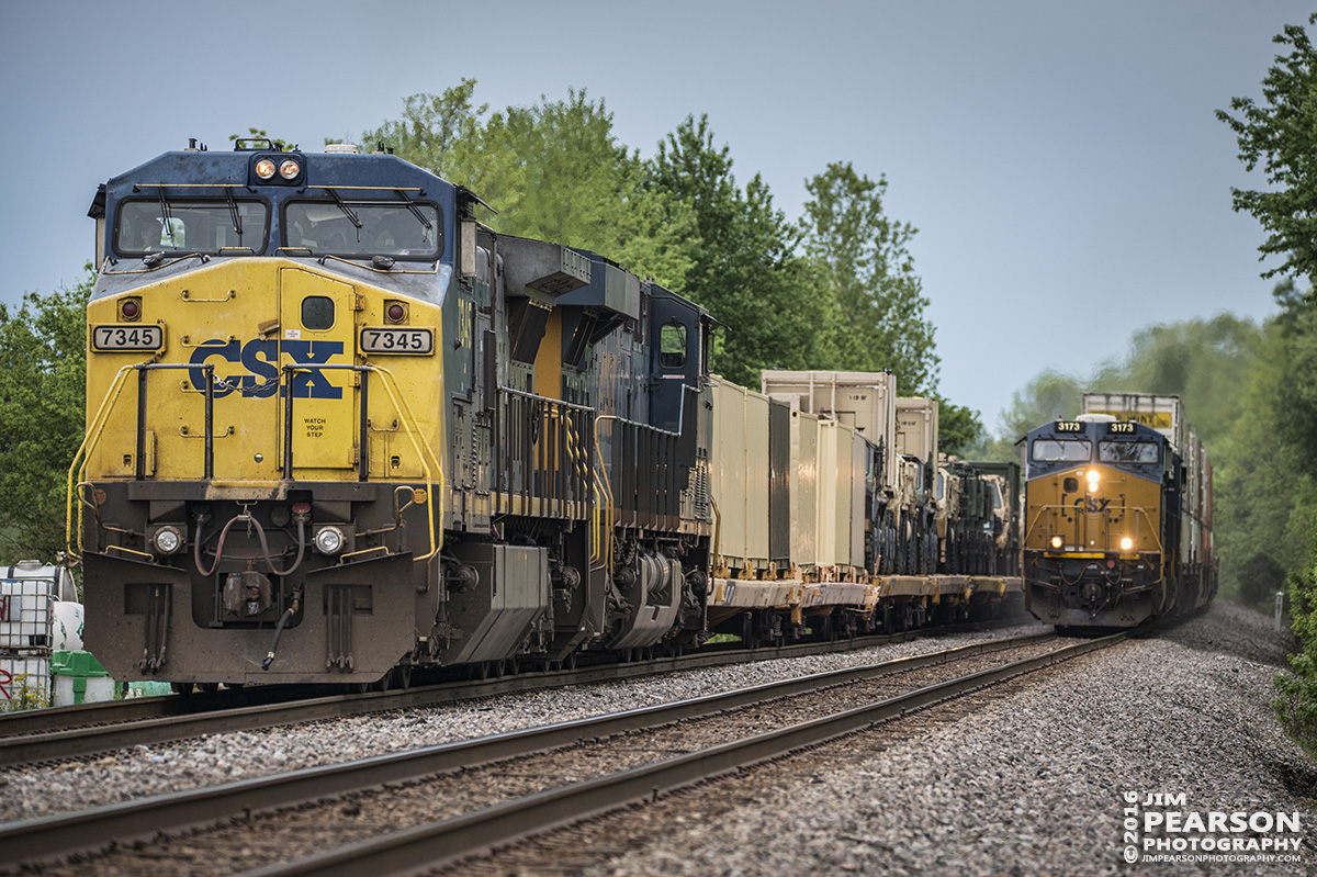 April 29, 2016 - CSX hot intermodal Q028 passes W876-26, with a loaded military train, at the north end of the siding at Slaughters, Ky on the Henderson Subdivision. - Tech Info: 1/1000 | f/5.3 | ISO 1000 | Lens: Sigma 150-600 @ 240mm on a Nikon D800 shot and processed in RAW.