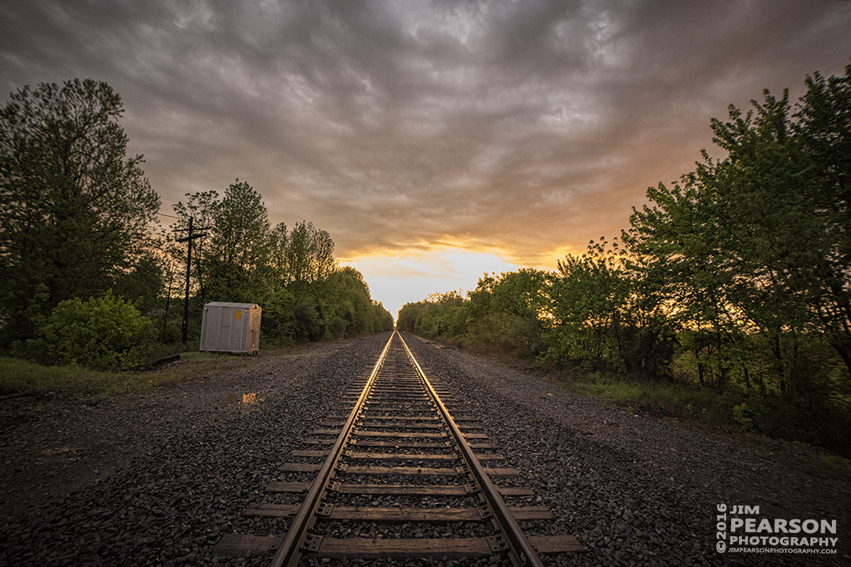 April 30, 2016 - The sun sets on the Paducah & Louisville Railway line at Madisonville, Ky an afternoon of rain showers. - Tech Info: 1/400 | f/2.8 | ISO 3600 | Lens: Rokinon 14mm on a Nikon D800 shot and processed in RAW.