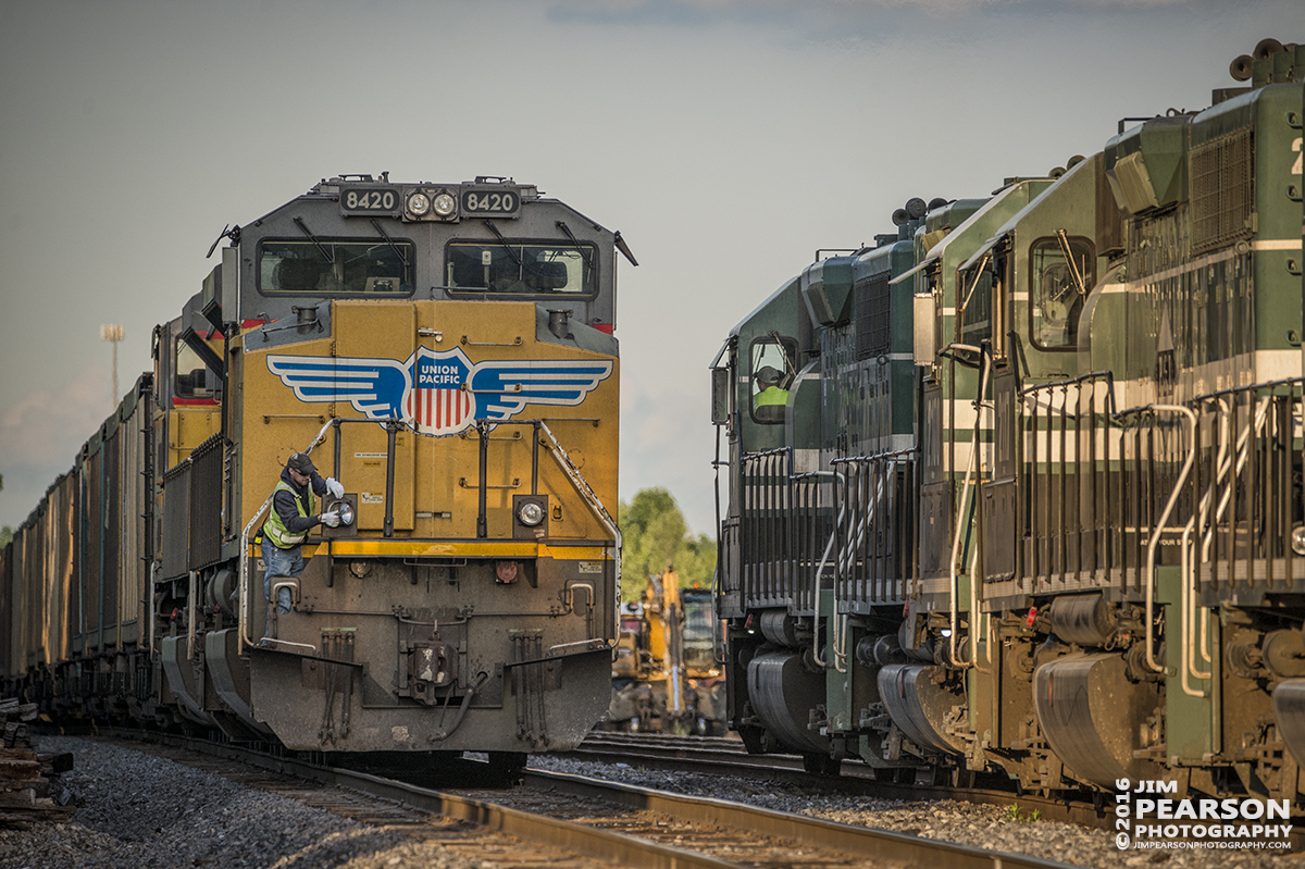 April 27, 2016 - At sunset a Paducah and Louisville Railway conductor changes a ditch light on UP 8420 as a northbound P&L local passes them at West Yard in Madisonville, Ky so they can move south with their loaded coke train to Calvert City, Ky. - Tech Info: 1/1000 | f/5.6 | ISO 800 | Lens: Sigma 150-600 @ 360mm on a Nikon D800 shot and processed in RAW.