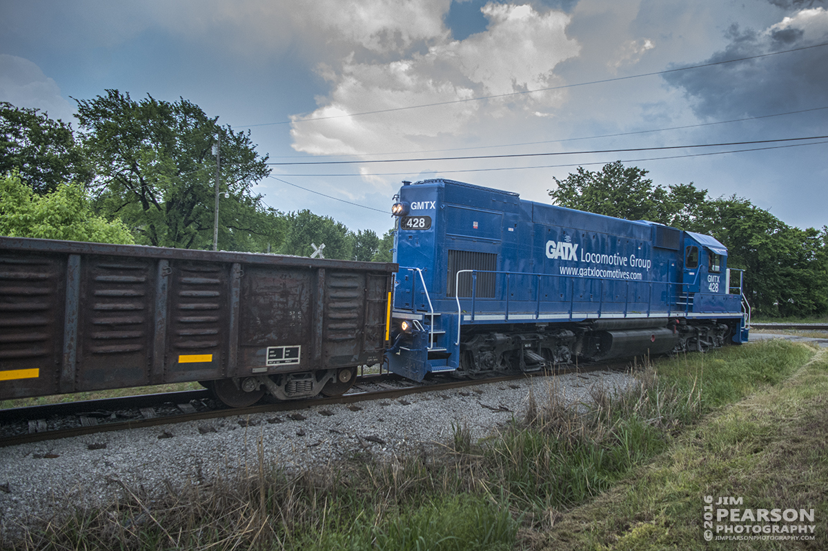 May 10, 2016 - Fredonia Valley Railroad's GATX/GMTX 428 lease unit begins to back its empty rock train the 7 miles back to Martin Marietta Materials after dropping off a load of rock at the Paducah and Louisville Railway yard in Princeton, Ky. - Tech Info: 1/800 | f/5 | ISO 1250 | Lens: Nikon 18mm on a Nikon D800 shot and processed in RAW. ?