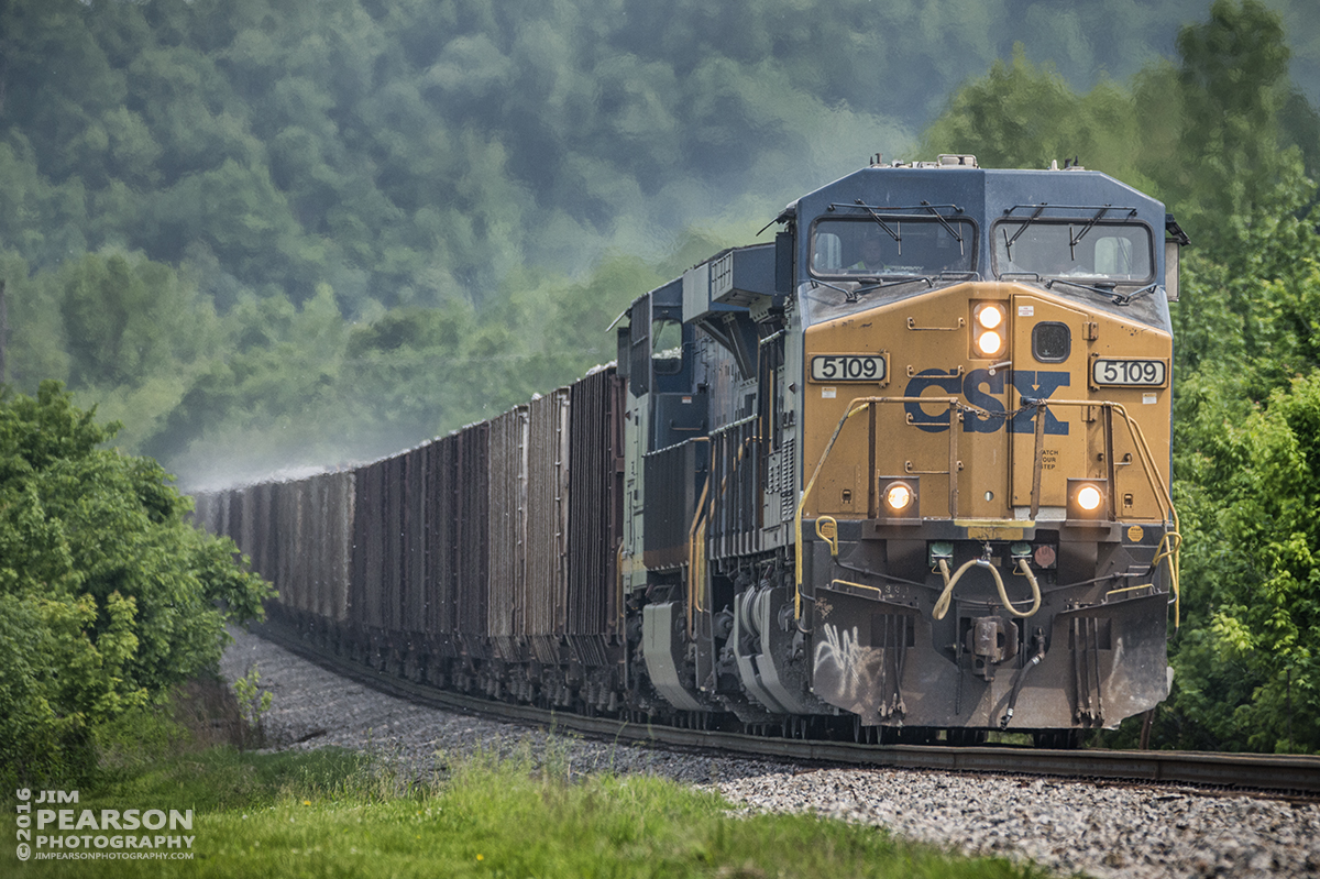 May 10, 2016 - Dust floats off CSX loaded ballast train, W082, as it heads into Earlington, Ky as it heads north on the Henderson Subdivision with CSXT 5109 in the lead. - Tech Info: 1/2000 | f/5.6 | ISO 800 | Lens: Sigma 150-600 @ 350mm on a Nikon D800 shot and processed in RAW.