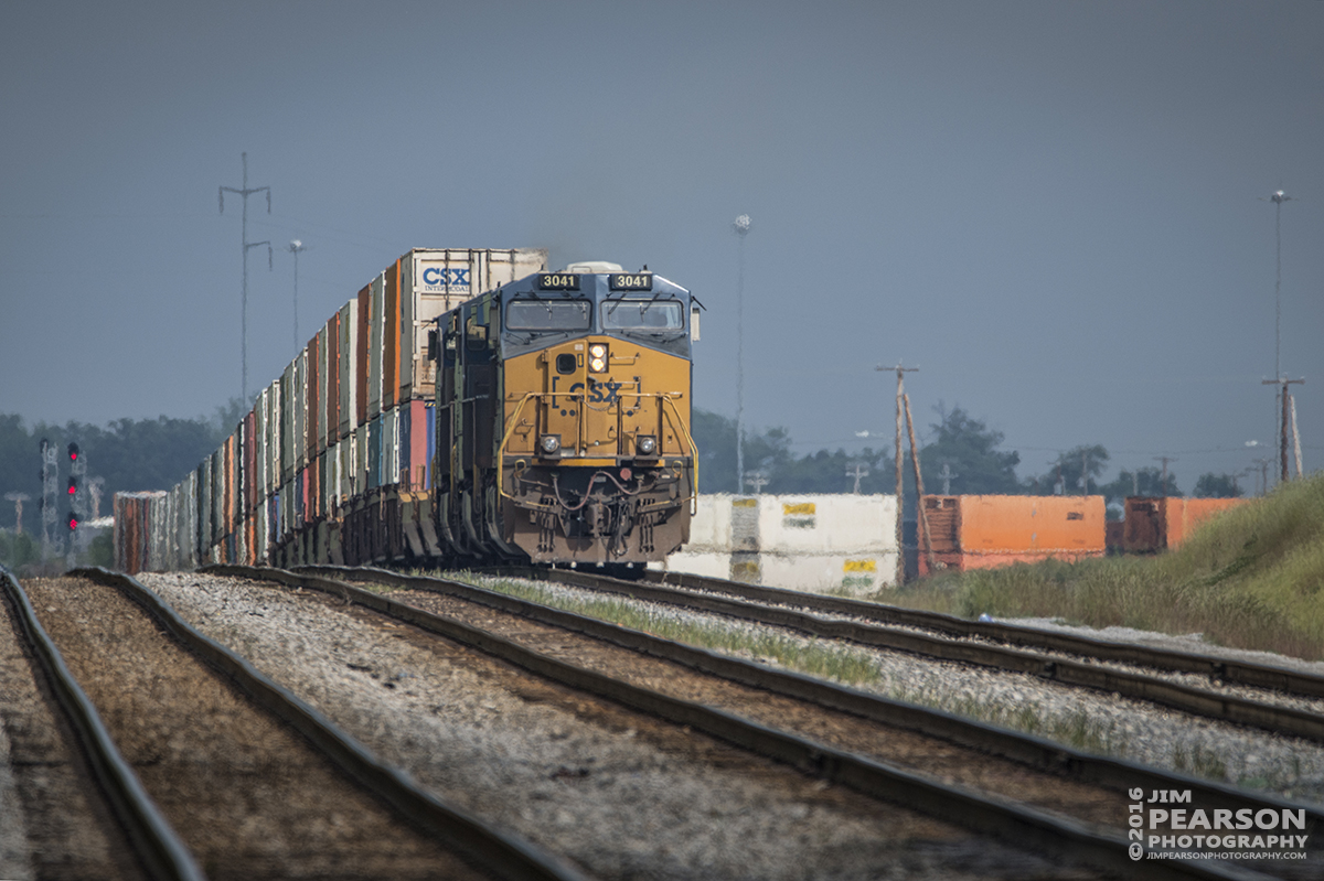 May 17, 2016 - The sun pops through the clouds just as CSX Q028-17 (Atlanta, GA - Chicago, IL) pulls out of Casky yard up the northbound lead at Hopkinsville, Ky as it heads north on the Henderson Subdivision with its priority intermodal train. - Tech Info: 1/800 | f/6.3 | ISO 280 | Lens: Sigma 150-600 @ 600mm on a Nikon D800 shot and processed in RAW.