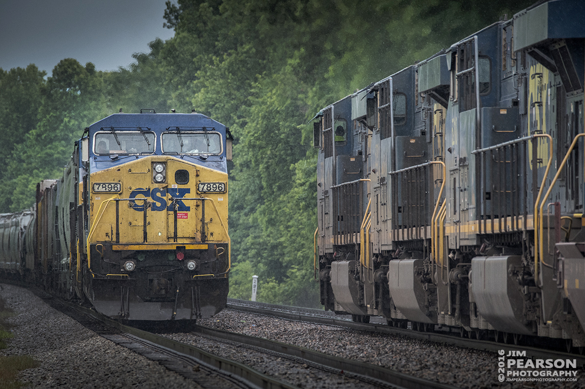 May 25, 2016 - Southbound CSX Q025-25 (Chicago, IL - Jacksonville, FL), right, passes northbound Q586 sitting in the siding at the north end of Slaughters siding, as the two trains meet in a light rain on the Henderson Subdivision at Slaughters, Ky. - Tech Info: 1/1250 | f/9 | ISO 3600 | Lens: Sigma 150-600 @ 450mm on a Nikon D800 shot and processed in RAW.