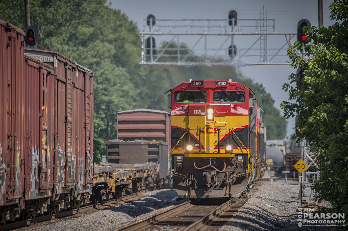 June 6, 2016 – CSX Q294-06 (Nashville, TN - Indianapolis, IN) passes through Guthrie, Ky, with KCS 4162, 4006, 3961 and 3949 as power, as it heads north on the Henderson Subdivision. - Tech Info: 1/160 | f/6 | ISO 100 | Lens: Sigma 150-600 @ 460mm with a Nikon D800 shot and processed in RAW.