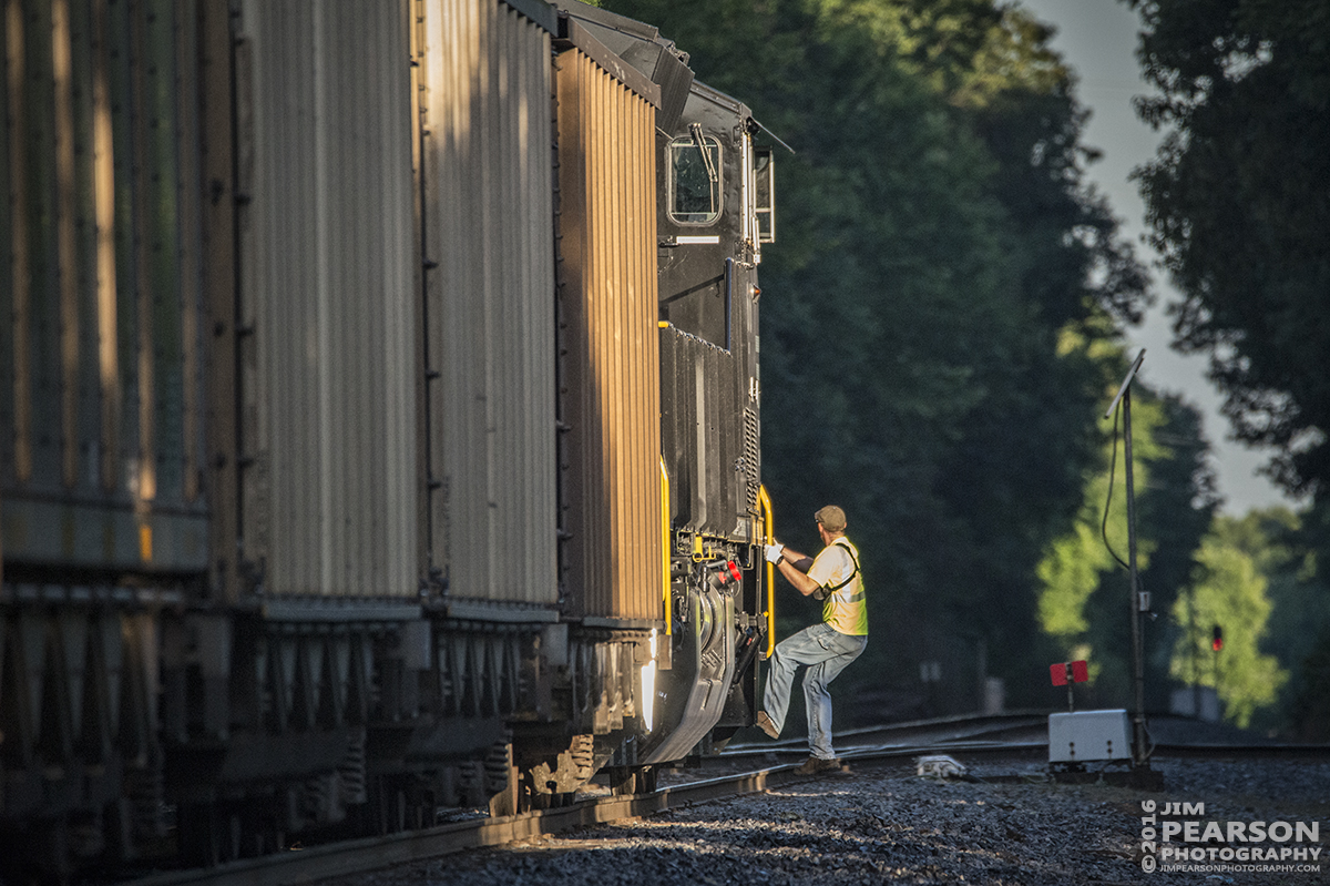June 8, 2016 – The conduction climbs back aboard Paducah and Louisville Railways LSX1, a Norfolk Southern Train with a brand new 3616 Tier 4 ET44AC leading on its first revenue run, after throwing the Pee Vee Spur switch at West Yard as they start their early morning run to Warrior Coal in Madisonville, Ky. - Tech Info: 1/2500 | f/6.3 | ISO 4000 | Lens: Sigma 150-600 @ 550mm with a Nikon D800 shot and processed in RAW.