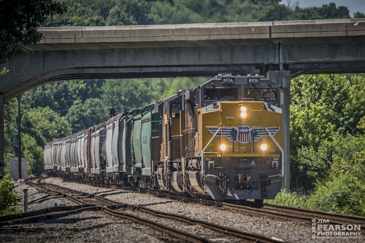 June 10, 2016 – CSX Q515 (Indianapolis, IN - Nashville, TN) passes under the I-69 overpass as Union Pacific 8956 leads it into the siding at Nortonville, Ky on its way south on the Henderson Subdivision. - Tech Info: 1/1600 | f/6 | ISO 720 | Lens: Sigma 150-600 @ 500mm with a Nikon D800 shot and processed in RAW.