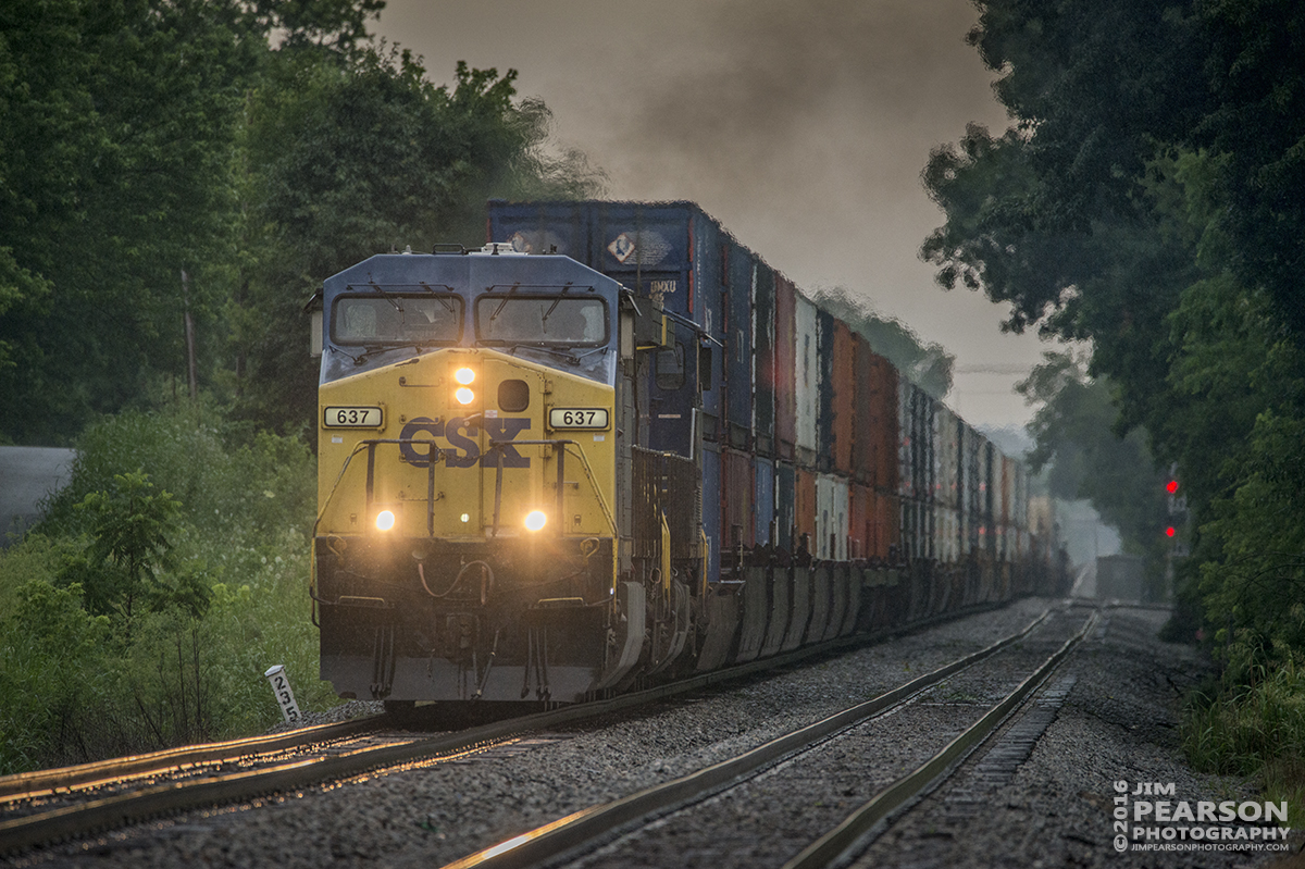 June 15, 2016 – CSX Q025-15 heads south at the north end of Casky at Hopkinsville, Ky as it prepares to head into Casky Inspection Yard to be refueled and inspected before continuing its trip on the Henderson Subdivision. - Tech Info: 1/500 | f/6.3 | ISO 1400 | Lens: Sigma 150-600 @ 600mm with a Nikon D800 shot and processed in RAW.