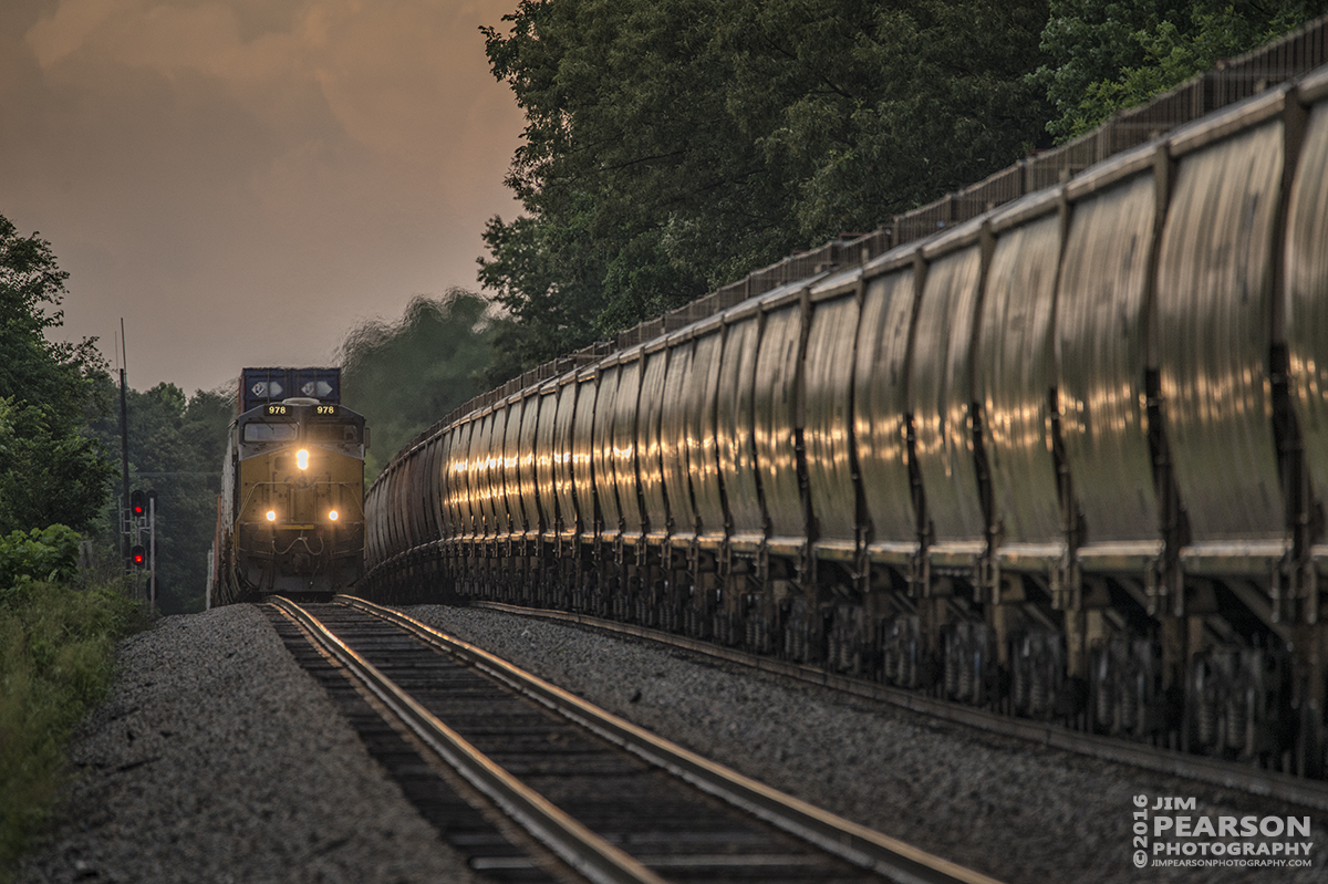 June 15, 2016 – Lights reflect off wet hopper cars as southbound CSX Q029-15 crests the north end of Crofton, Ky passing CSX G127, a northbound empty grain train, after a storm front passed through the area on the Henderson Subdivision. - Tech Info: 1/500 | f/6.3 | ISO 800 | Lens: Sigma 150-600 @ 600mm with a Nikon D800 shot and processed in RAW.