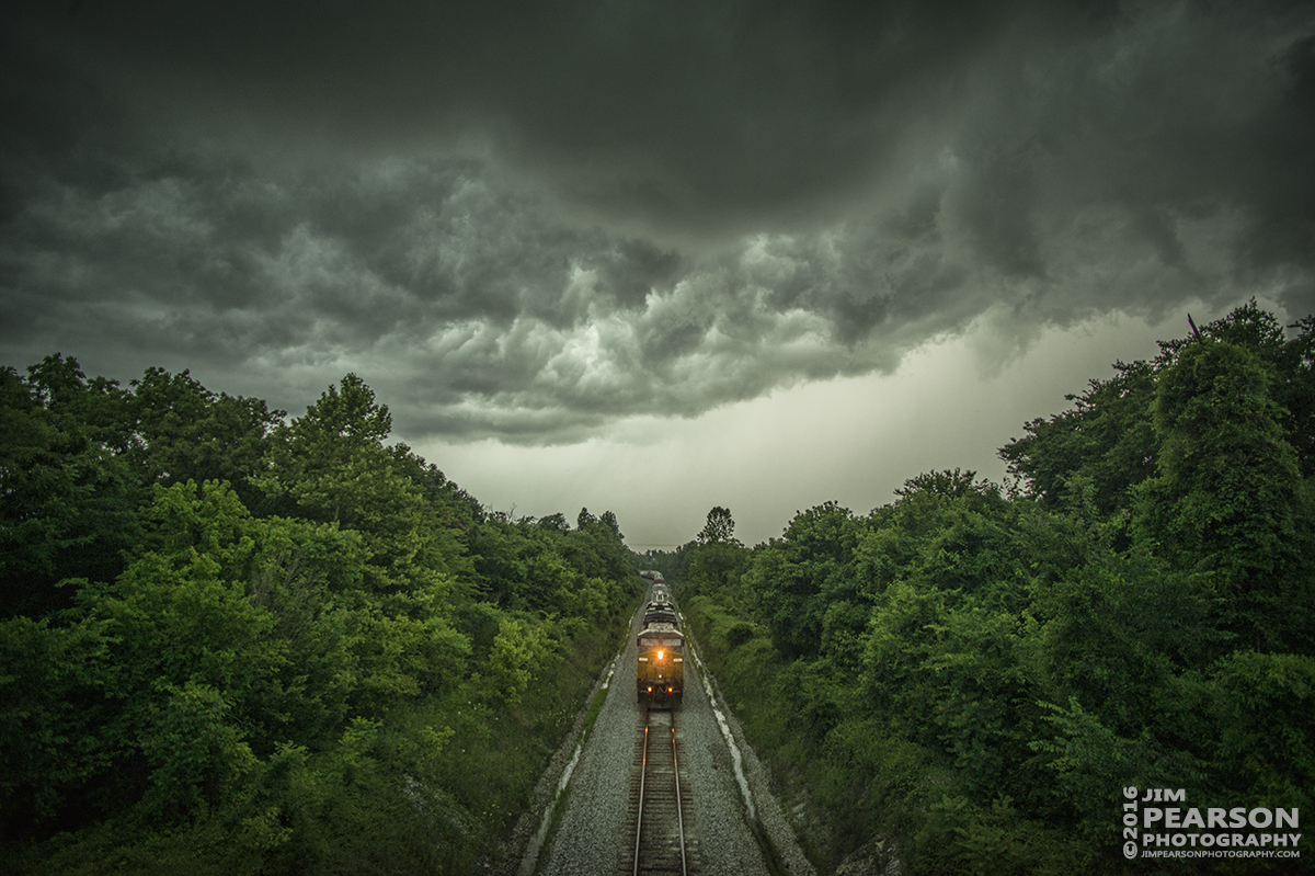 June 15, 2016 – I chased the leading edge of this storm front for about 20 miles till I finally caught CSX Q592-15 approaching the south end of the siding at Kelly, Ky as it headed north on the Henderson Subdivision. As dark and nasty as the sky looked, all it did was dump a lot of rain and create some lighting and fortunately for me it didn't do it while I was shooting! - Tech Info: 1/400 | f/2.8 | ISO 900 | Lens: Nikon 18mm with a Nikon D800 shot and processed in RAW.