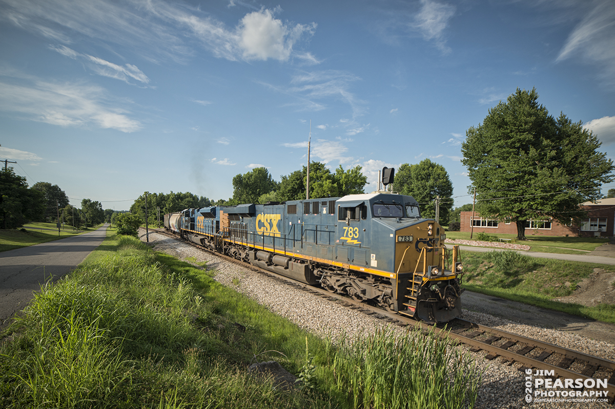 June 28, 2016 – CSX daily manifest train Q645-27 (Chicago, IL (Barr Yard) - Nashville, TN) heads under the highway 41 bridge at Mortons Gap, Ky as it makes its way south on the Henderson Subdivision. - Tech Info: 1/2000 | f/2.8 | ISO 720 | Lens: Rokinon 14mm with a Nikon D800 shot and processed in RAW.