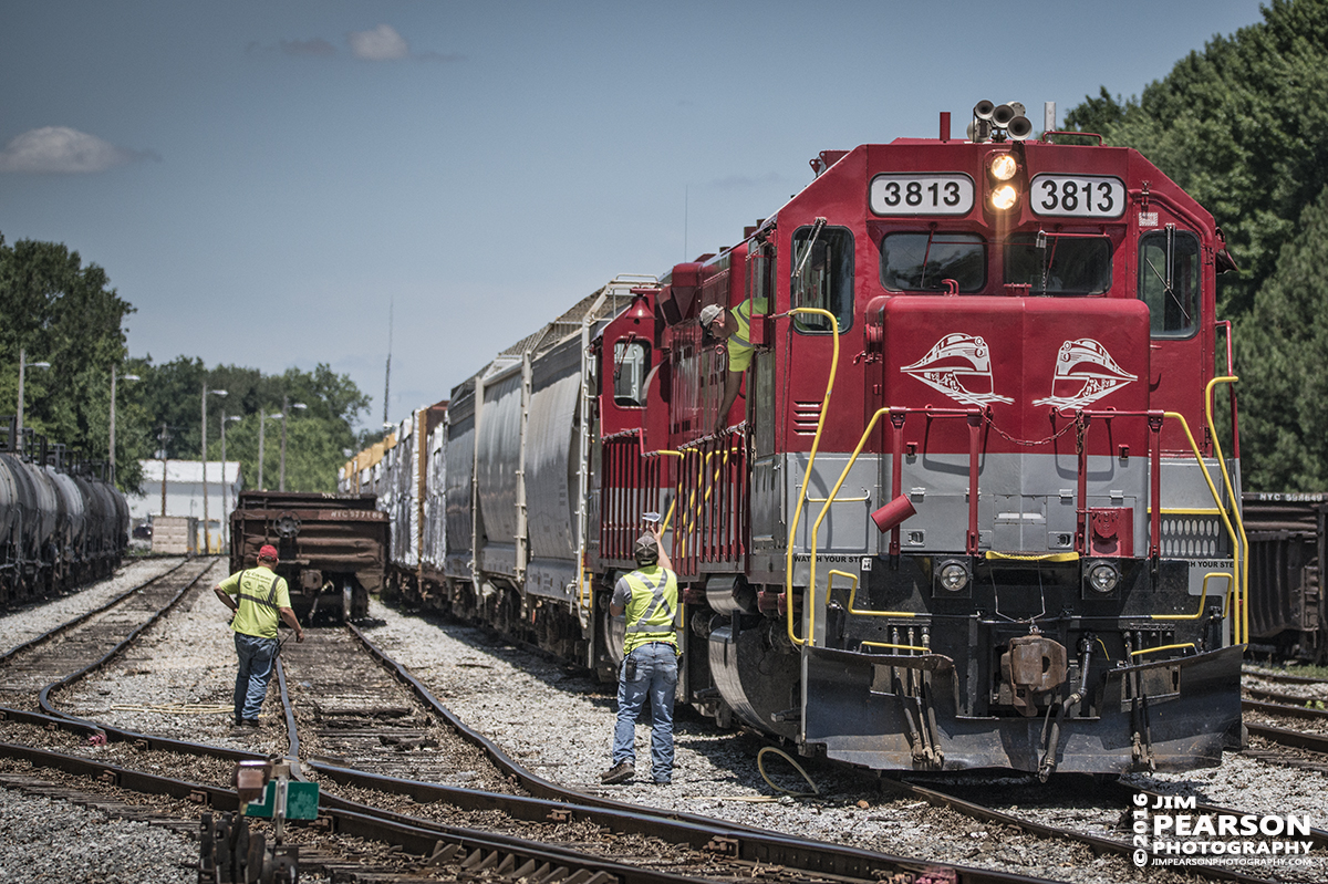 June 29, 2016 – Engineer on RJ Corman's 3813 drops a car manifest to a waiting crewman on the ground after arriving at CSX's Guthrie Yard in Guthrie, Ky. - Tech Info: 1/6400 | f/5 | ISO 640 | Lens: Sigma 150-600 @ 150mm with a Nikon D800 shot and processed in RAW.