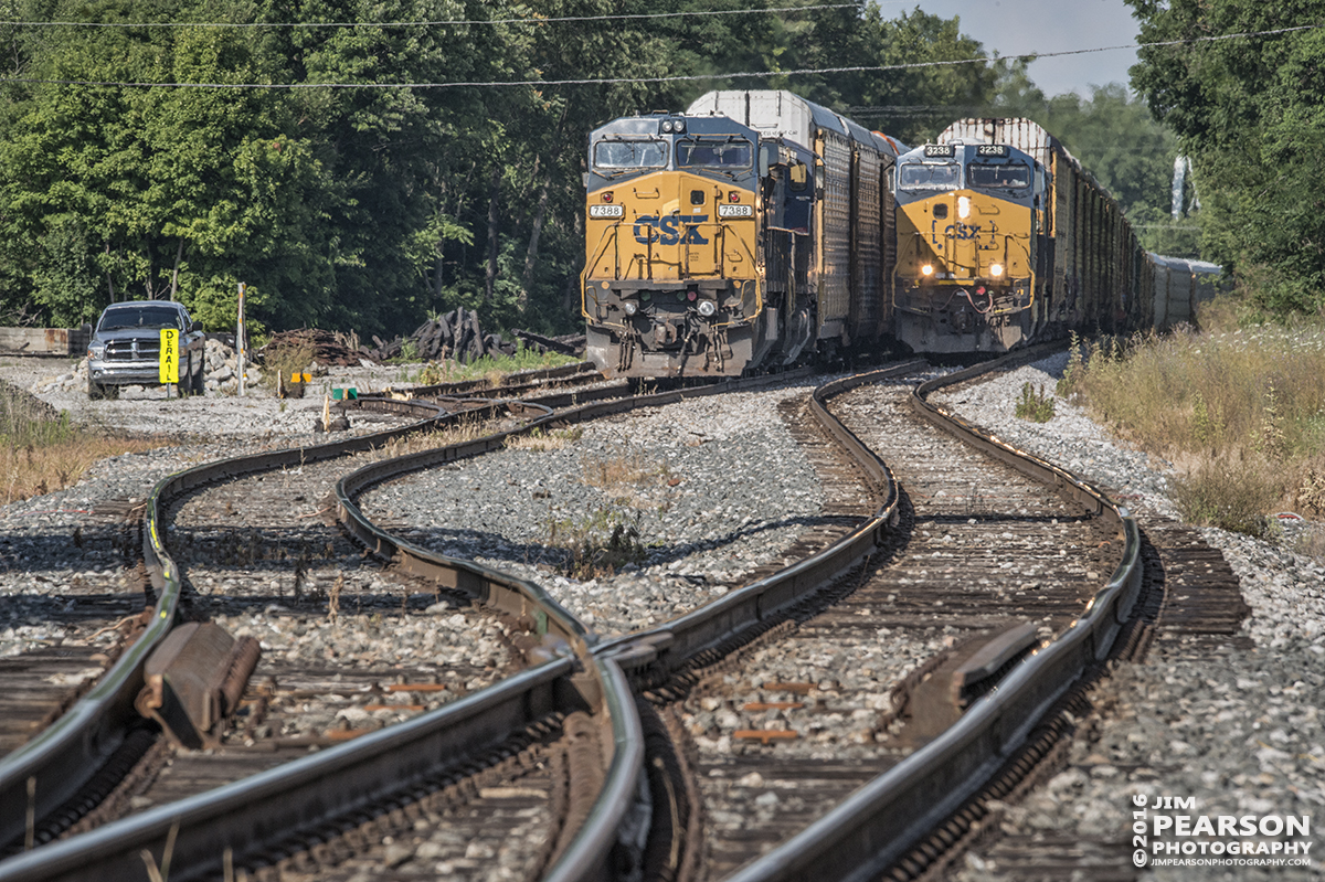 July 1, 2016 – Autorack CSX Q241-30 (Detroit, MI - Louisville, KY) creeps past another waiting autorack in the siding at La Grange, Ky as they head south to Louisville, Ky on the Short Line (LCL Subdivision). - Tech Info: 1/400 | f/20 | ISO 1400 | Lens: Sigma 150-600 @ 400mm with a Nikon D800 shot and processed in RAW.