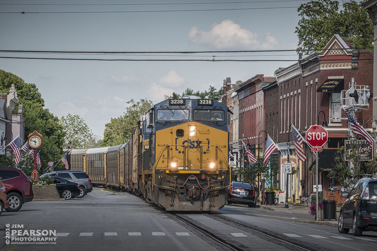 July 1, 2016 – Autorack CSX Q241-30 (Detroit, MI- Louisville, KY) makes its way through downtown La Grange, Ky (one of the few places in the state that has street running) as it heads south to Louisville, Ky on the Short Line (LCL Subdivision). - Tech Info: 1/400 | f/20 | ISO 900 | Lens: Sigma 150-600 @ 165mm with a Nikon D800 shot and processed in RAW.