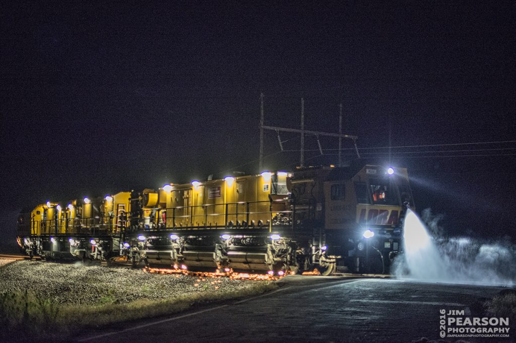 July 9, 2016 – LORAM Railgrinder RGS-9 sprays water as it grinds the through the crossing at the south end of Rankin Siding at Rankin, Ky on CSX's Henderson Subdivision. - Tech Info: 1/160 | f/1.4 | ISO 4000 | Lens: Nikon 50mm on a Nikon D800 shot and processed in RAW.